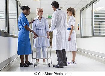 Senior Female Hospital Patient in Walking Frame Doctor Nurse