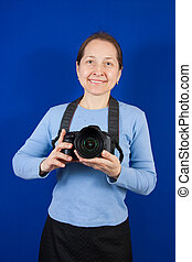 senior female photographer with camera