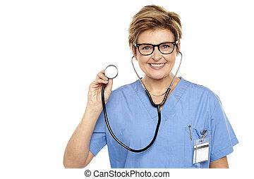 Senior female physician ready to examine you. All on white...