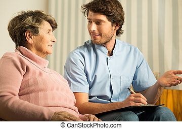 Senior female talking with doctor