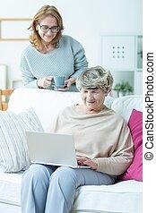 Senior female with laptop