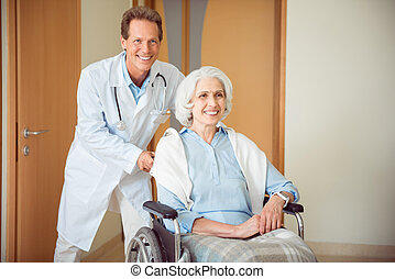 Senior female woman with her doctor