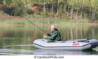 Senior fisherman fishing on the lake