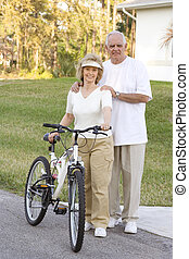 Senior Fitness - Attractive and fit seniors on bikes ...