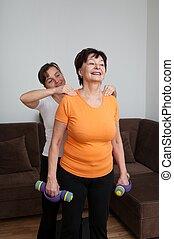 Senior fitness woman receiving mass