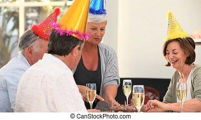 Senior friends celebrating a birthday