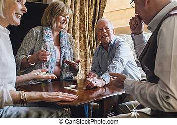 Senior Friends Playing Dominoes