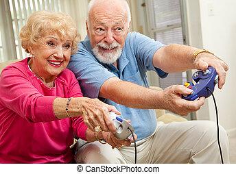 Senior couple having fun playing video games.