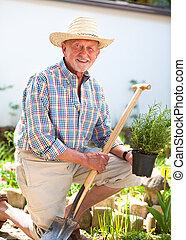 Senior gardener with a spade
