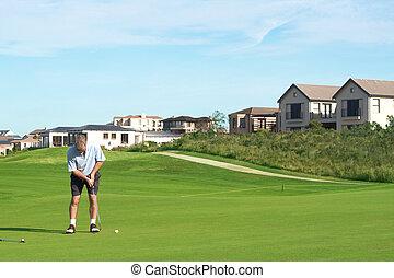 Senior golfer playing golf