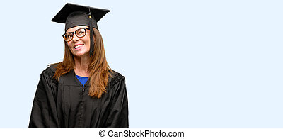Senior graduate student woman thinking and looking up expressing doubt and wonder