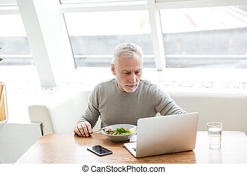 Senior grey-haired bearded businessman - Picture of a mature...