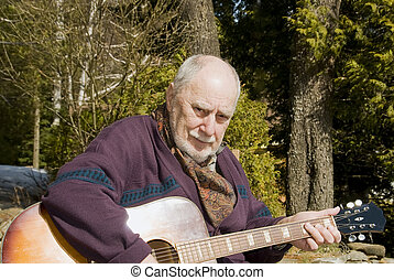 senior guitarist in the garden