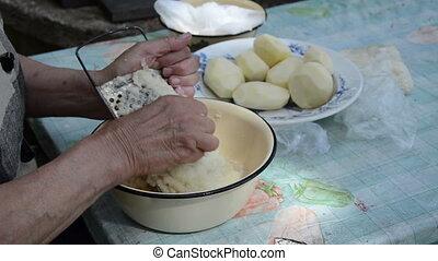 senior hand grater potato - senior woman hand grater potato...