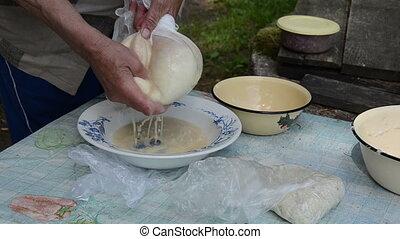 senior hand potato strain - Senior woman hands strain...