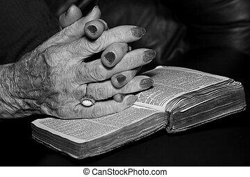 Senior hands in prayer