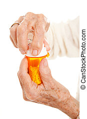 Senior Hands on Prescription Bottle