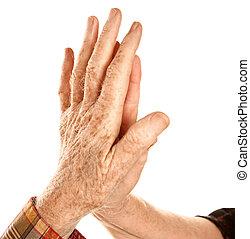 Senior hands touching