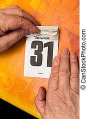 senior  hands with calendar 31 December