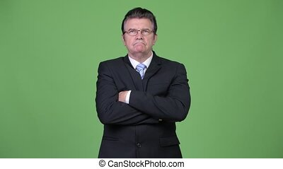 Senior handsome businessman with arms crossed - Studio shot...