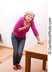 senior has heart ache - female senior has heart ache