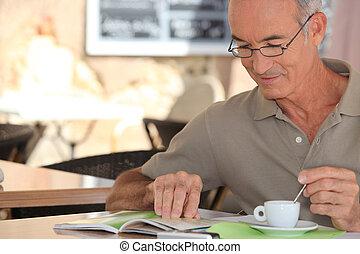 senior having cup of coffee