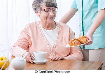 Senior having home medical care