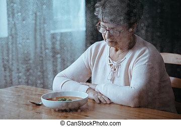 Senior having lack of appetite - Sad, senior woman having ...