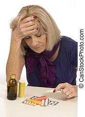 Senior health and medicine-woman having a headache - Senior...