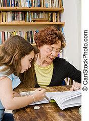 senior helping child doing homework