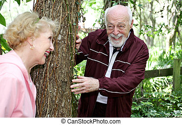 Senior Hide and Seek - A senior husband and wife playing...