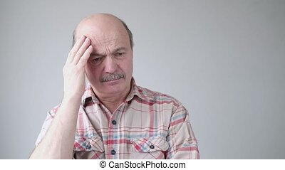 Senior hispanic man trying to remember something or having ...