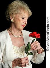 Senior Holds Rose