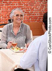 senior in a restaurant