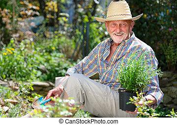 Senior in garden - Portrait of senior man gardening