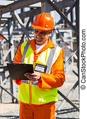 senior industrial technician taking readings