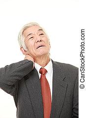 senior Japanese businessman suffers from neck ache - senior...