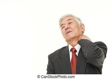 senior Japanese businessman suffers from neck ache - studio...