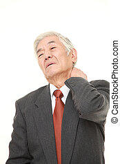 senior Japanese businessman suffers from neck ache -...