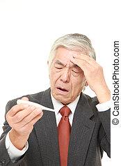 senior Japanese businessman with fever