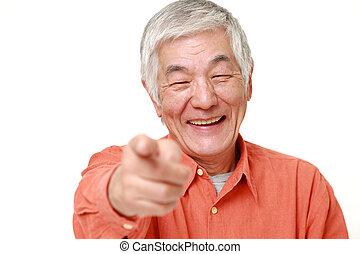 studio shot of senior Japanese man in a orange shirts