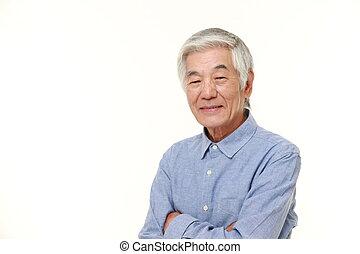 senior Japanese man smiles - studio shot of senior Japanese...