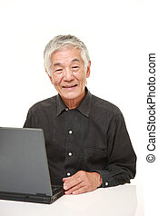 senior Japanese  man using laptop computer