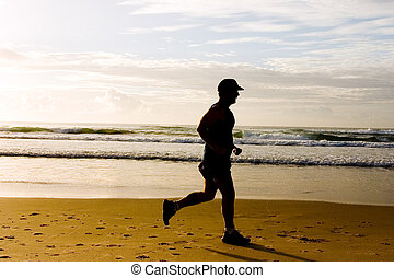 Senior jogging at the beach