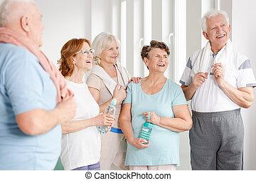 Senior ladies holding bottles