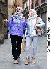 Senior ladies on roaming around city - Two smiling senior ...