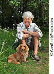 Senior lady and dog - Senior lady outside with her dachshund...
