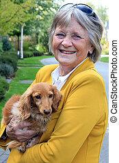 Senior lady and her dog.