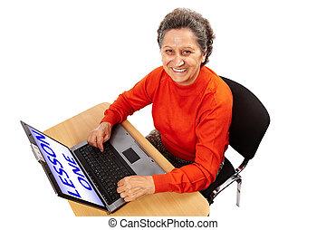 Senior lady at the computer