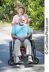 Senior Lady Cares for Husband